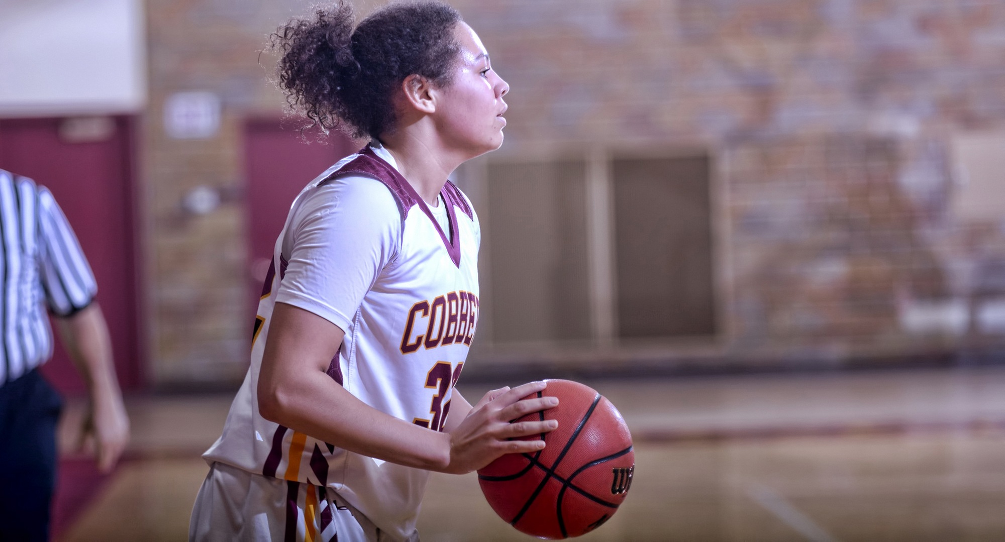 Sophomore Aleya Parker looks to make an entry pass during the second half of the Cobbers' win against Macalester. She finished with a career-high 16 points.