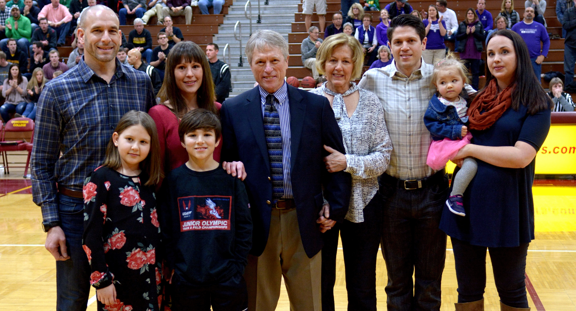 Concordia head coach Rich Glas is surrounded by his wife, kids and grandkids before the final game of his legendary 37-year career.