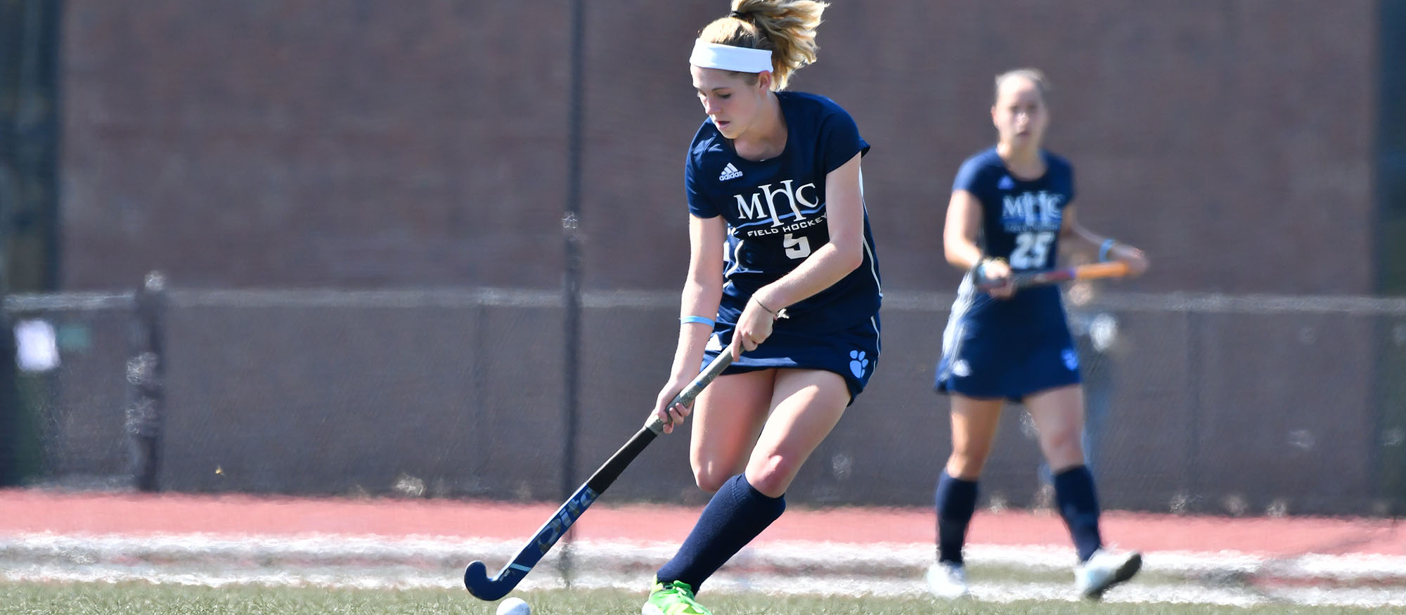 Action photo of Lyons field hockey player Anna Ballou