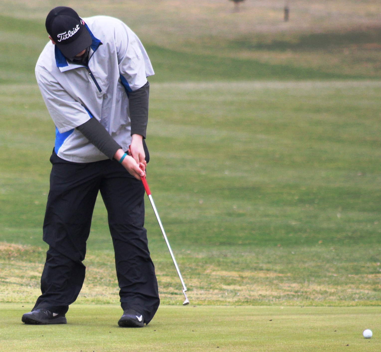 Devin Koob putts on hole No. 1 on Friday at the Lake Panorama Golf Course.