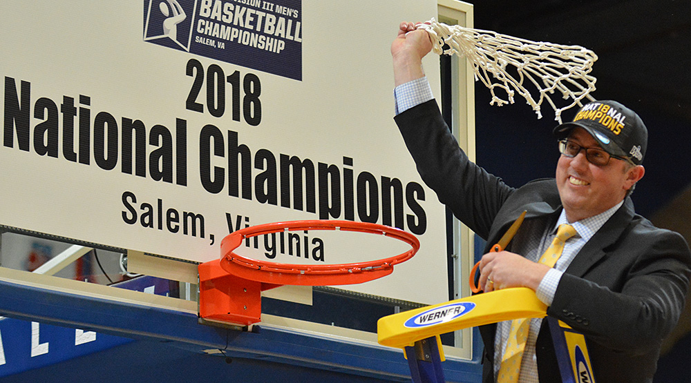 Dale Wellman cutting the net down