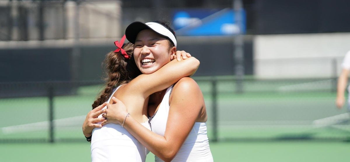 Sydney Lee gets a celebratory hug after her clinching singles win (photo by Alicia Tsai)