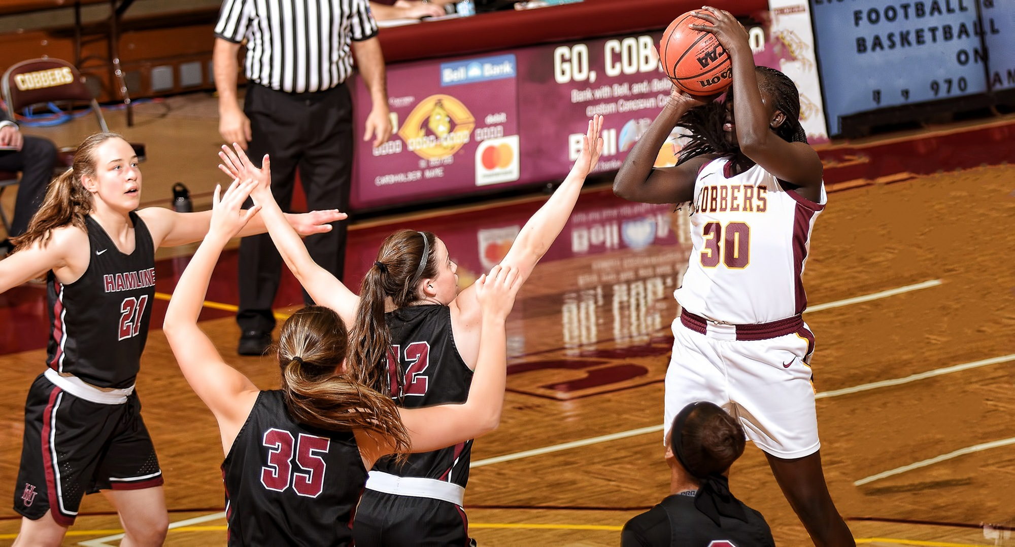 Sophomore Mary Sem goes up for two of her career-high 34 points among four Hamline defenders in the Cobbers' game with the Pipers.