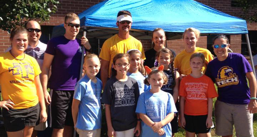 Tech student-athletes help at Capshaw Elementary School Cougar Run