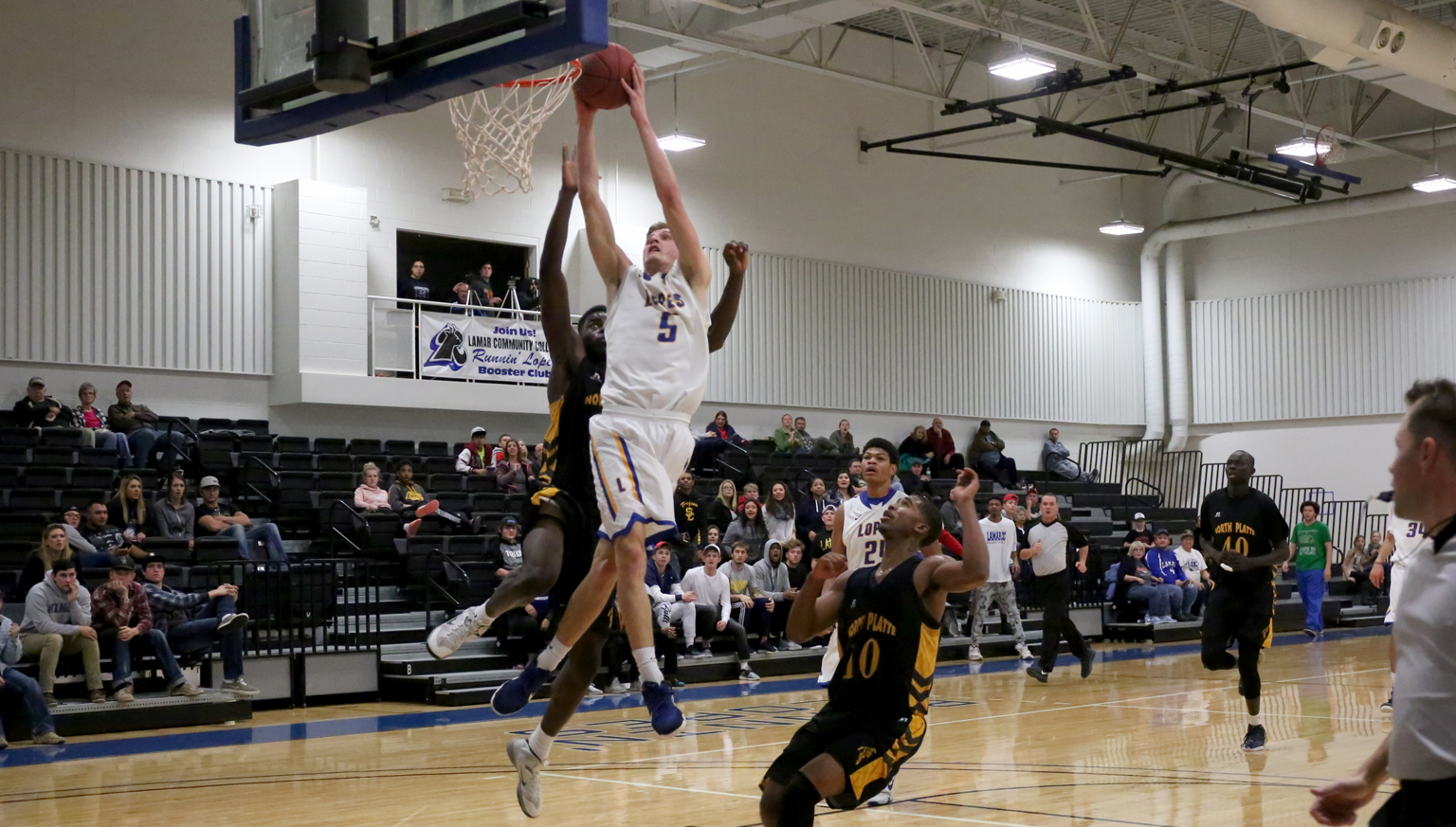 Michael Skinner beats his defenders to the basket in action against North Platte Community College on December 10.