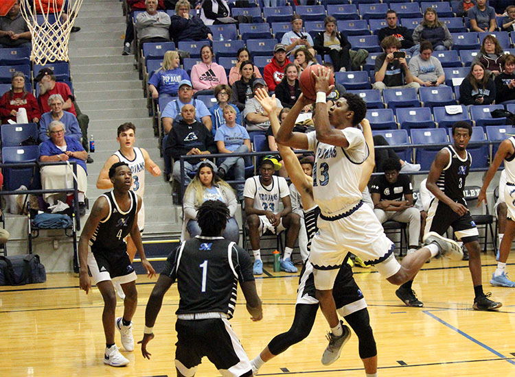 Sophomore Eddie Davis scores two of his 27 points in a game against McCook Community College Nov. 19 at the Community Building. The Trojans beat the Indians 81-71.