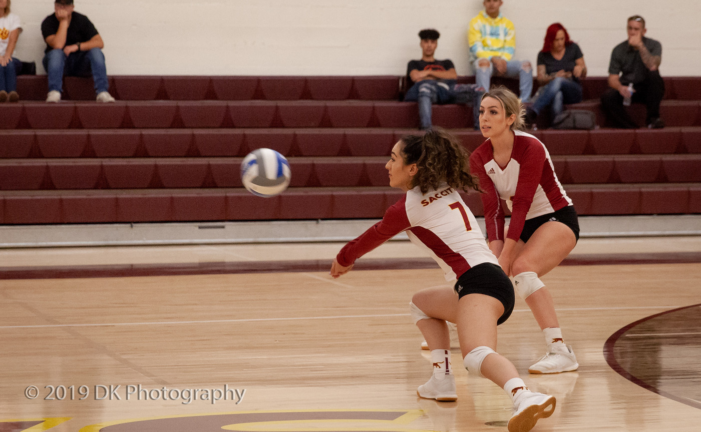 Nadia Sabbaghian (#7), City College freshman leans to dig the serve in the match against Modesto Junior College at the North Gym on Oct. 11th.