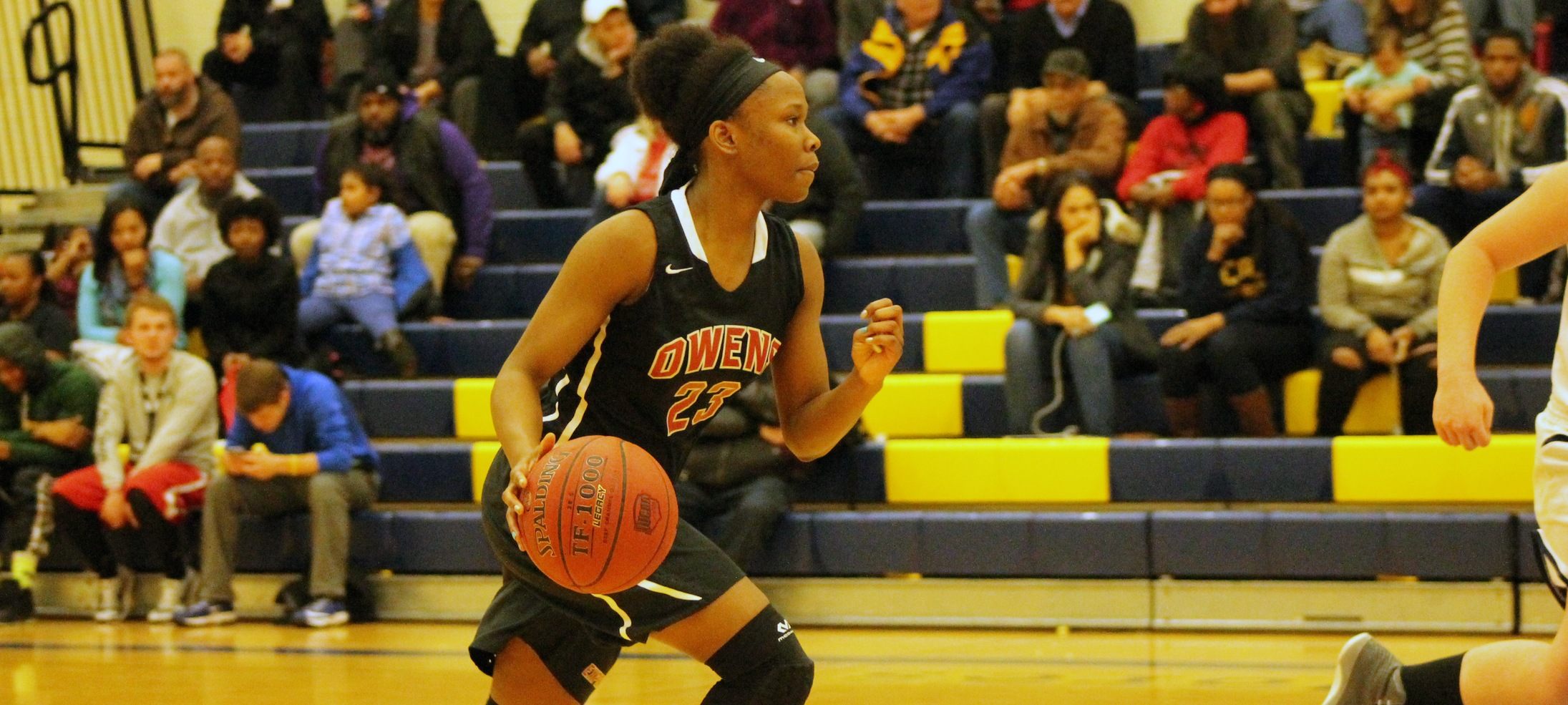 Denissa Sly brings the ball up the court against Lorain County. Photo by Nicholas Huenefeld/Owens Sports Information