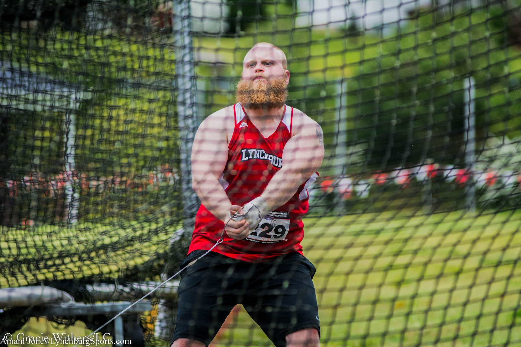 Evan Griffey throws the weight at an outdoor meet last year.
