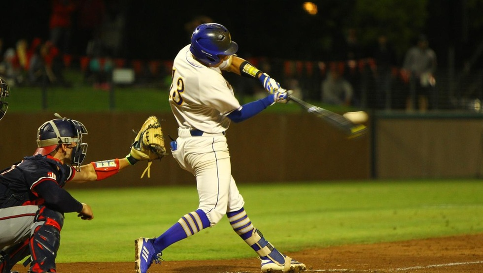 Andrew Martinez connects for UCSB's first hit in its game against Fresno State. (Photo by Bill Truong)