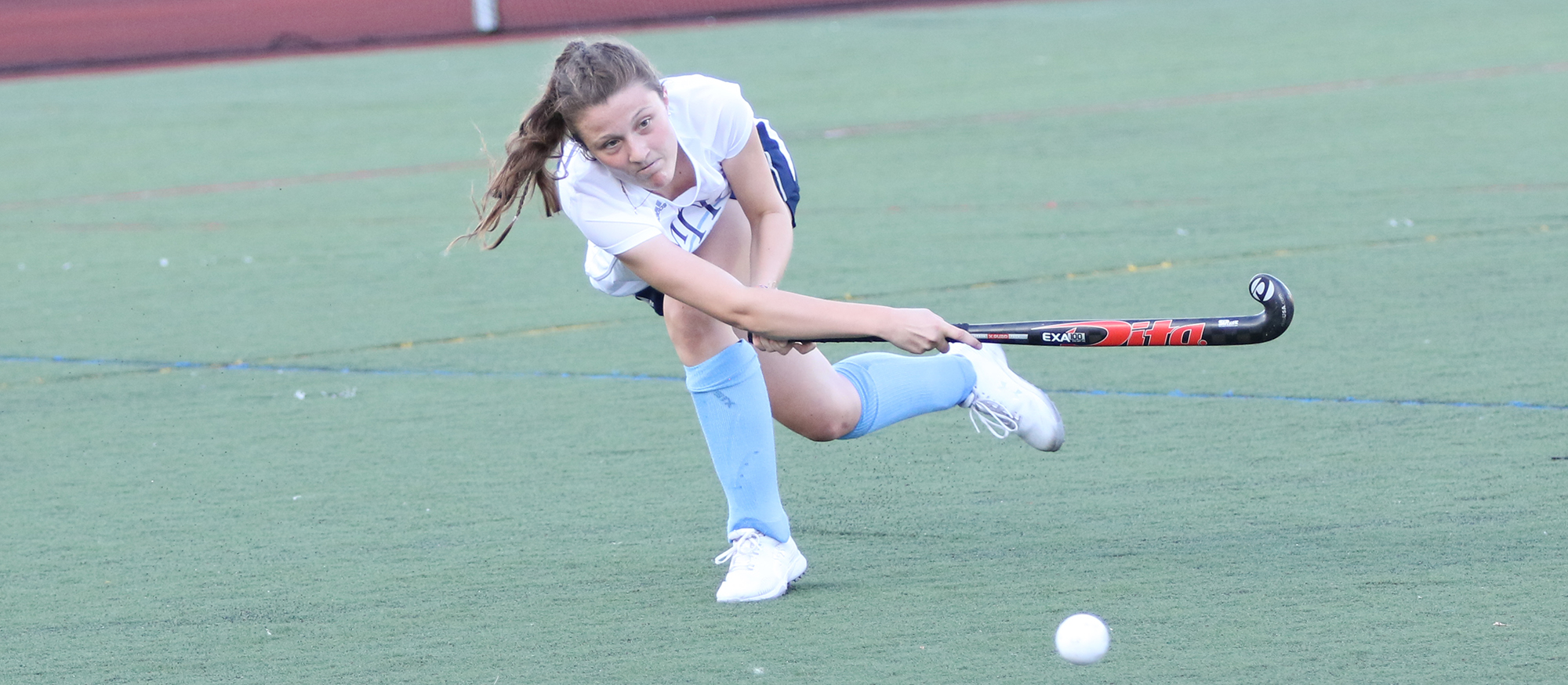 Action photo of Lyons field hockey player, Abby Baldwin. Photo credit to Perry Laskaris.
