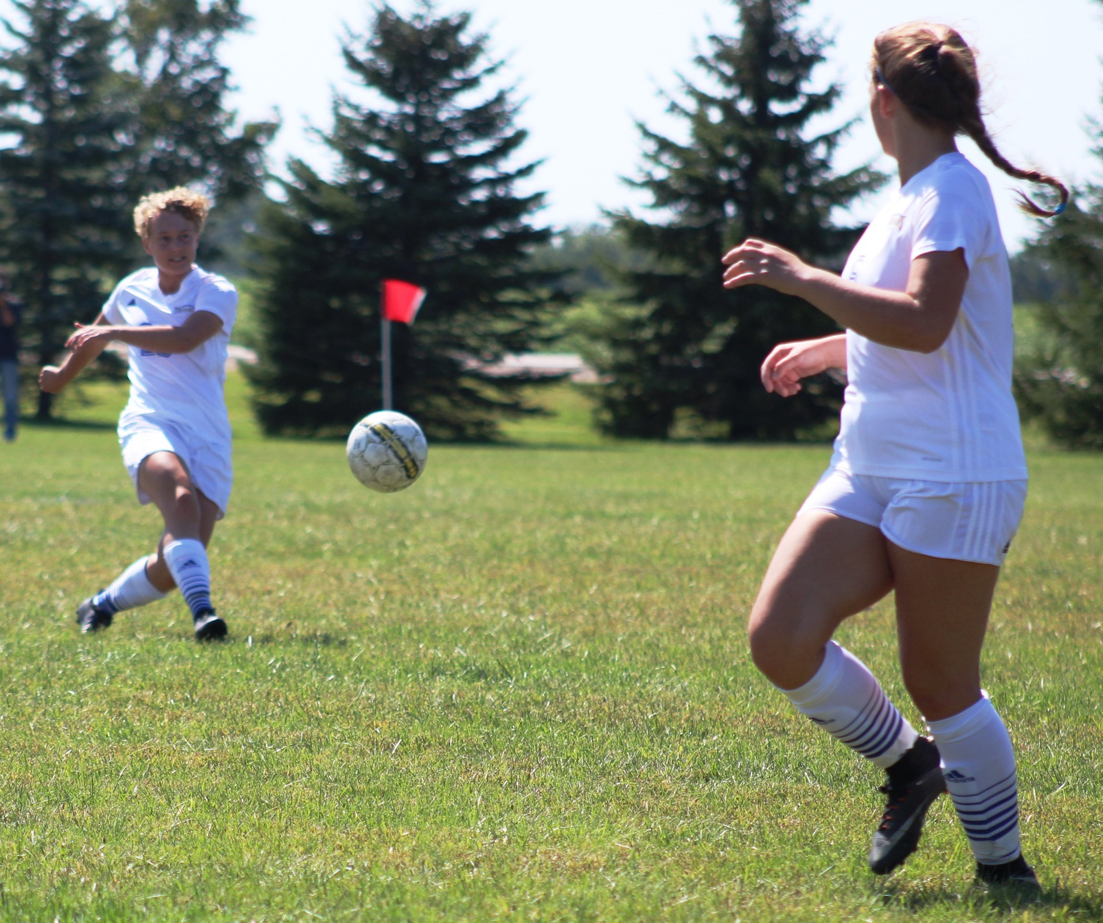 NIACC's Rosie Freeman passes the ball upfield in Saturday's match against Hawkeye CC.