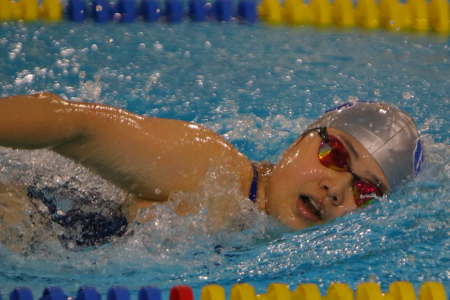 GCC Women Swimmer close-up during competition