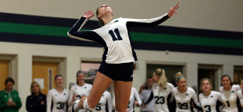 Emma Mancini swings through a jump serve.
