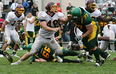 Senior Paul Cynewski holds his ground against Delaware Valley's strong offense.