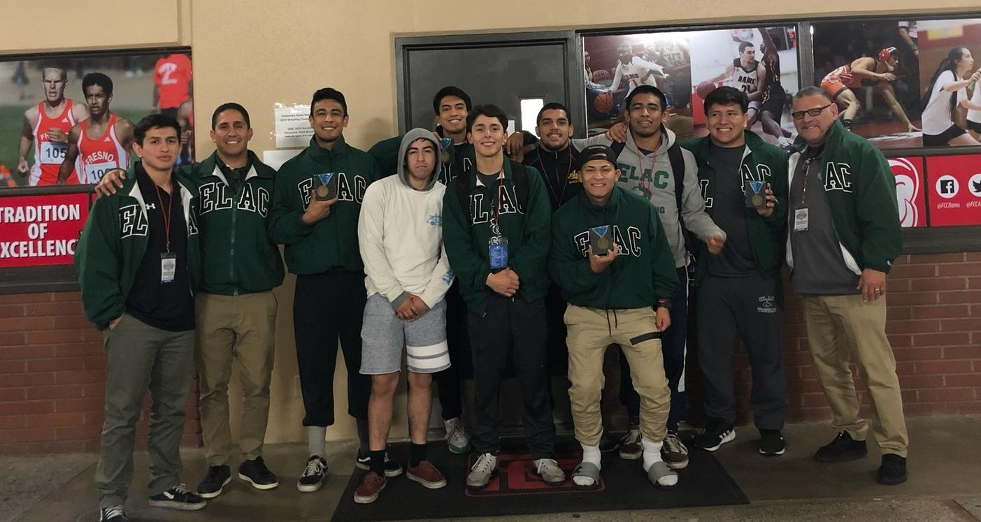 Coach Valle (right) pictured with the ELAC Wrestling team at the 2019 State Championships.