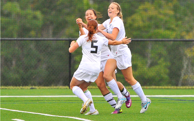 Freshman Brooke Mortensen celebrates with teammates following her first goal as a Knight against EMU on Thursday. Photo by Justo Photography.
