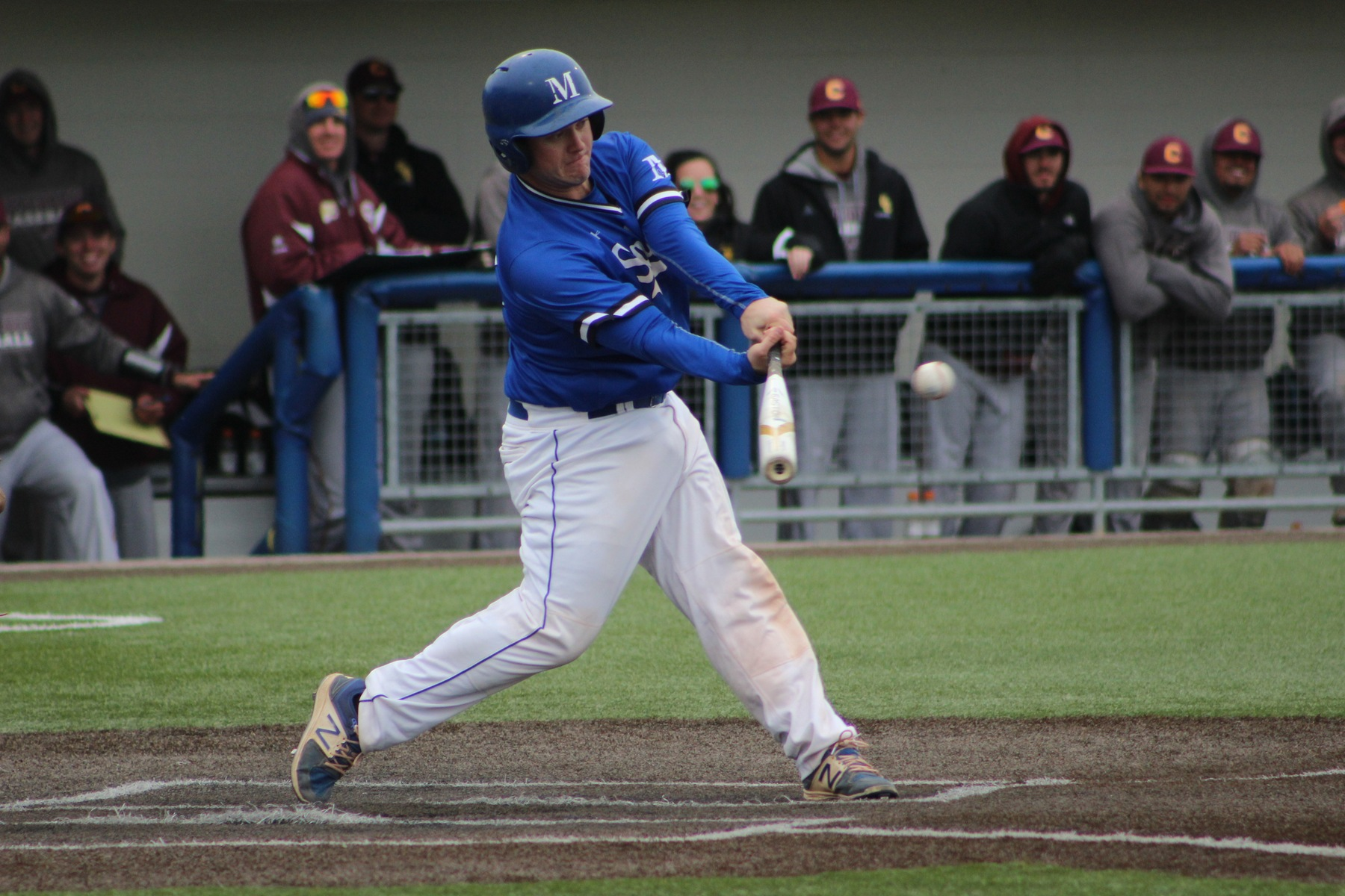 Michael Pappas drives a single to right field.