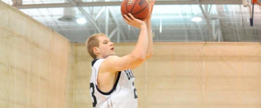 Senior guard Vytas Kriskus joins the 1,000 point club but Brandeis Men's basketball falls to Chicago 80-66