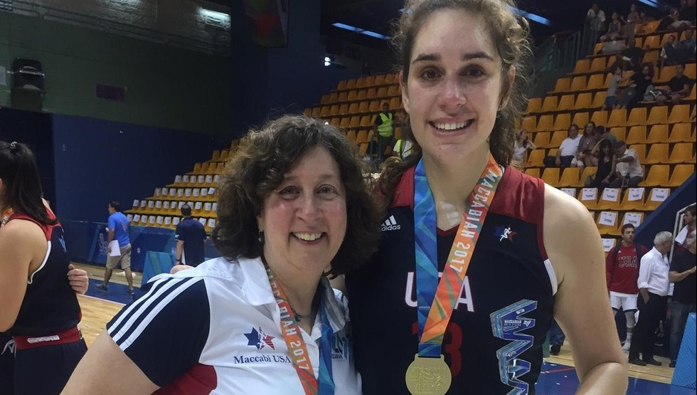 Tournament MVP Drew Edelman (right) alongside Team USA head coach Sherry Levin