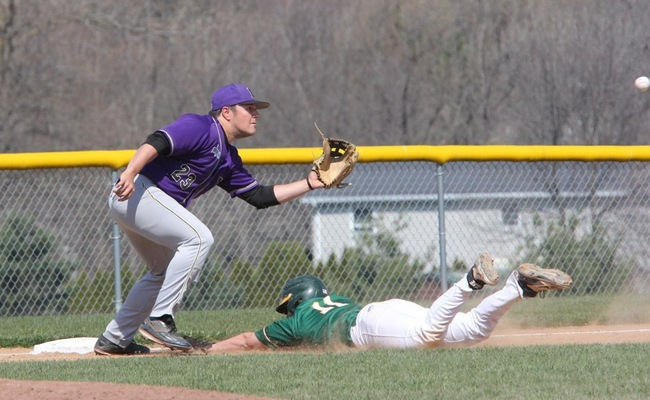 Dakota Skinner (11) dives into third in Game 1 against Houghton College on Saturday -- Photo by Ed Webber