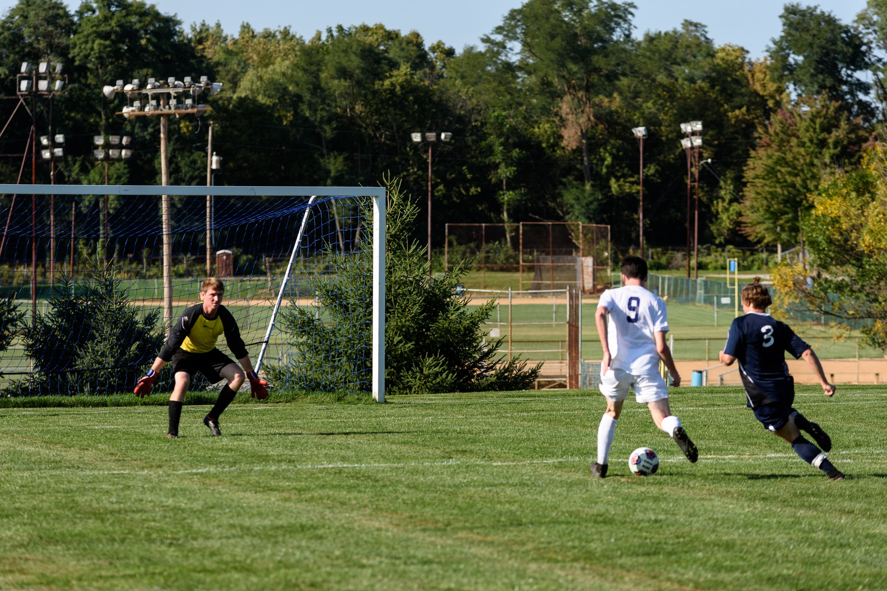 Carter Miller shooting the ball past the goalie.