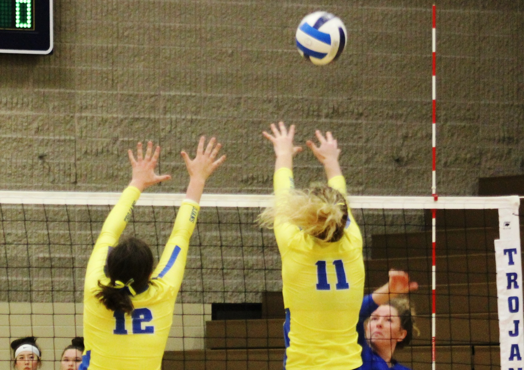 NIACC's Hannah Hanson (12) and Shelby Heston try for the block in Wednesday's match against Iowa Lakes.