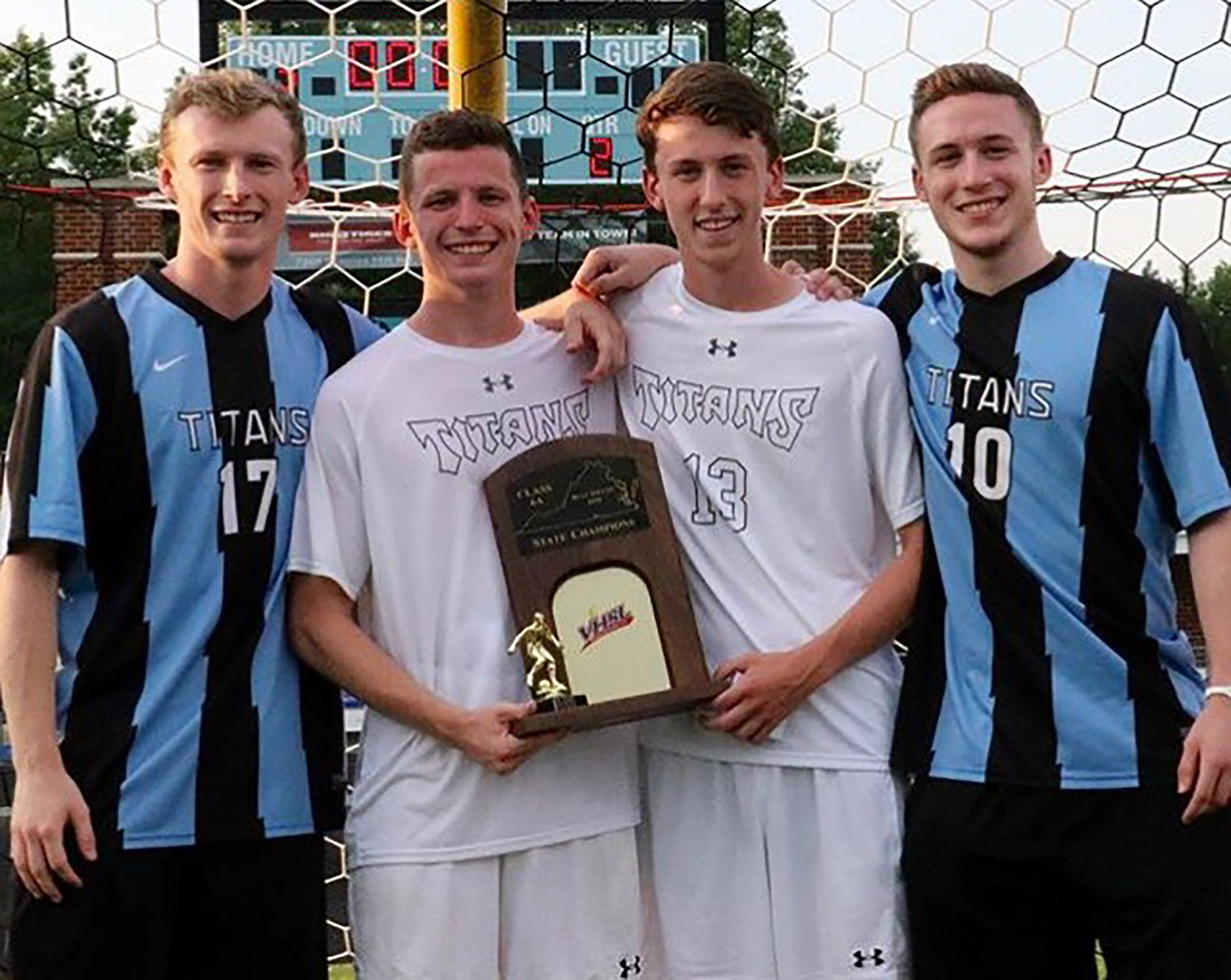 The Pikunas brothers (left to right) -- Ryan, Patrick, Quinn, and Chris -- pose after their high school captured the 2018 state championship. (Courtesy photo/Pikunas family)