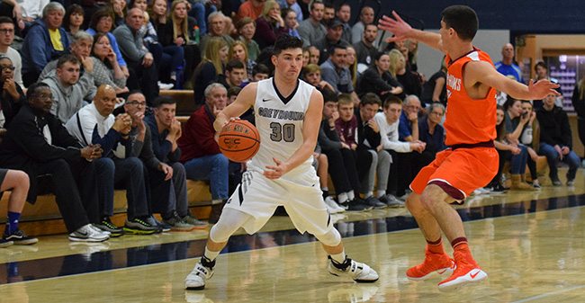 Matt Cardonne '18 looks to drive to the basket against Susquehanna University in the 2017 Landmark Conference Semifinals.