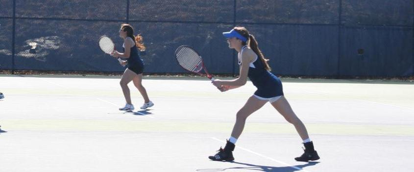 Brandeis swept doubles action