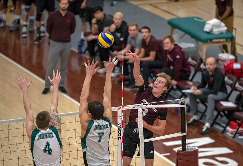 Jordan Peters tries for a kill in the face of a Huskies double block on Friday night (Robert Antoniuk photo).