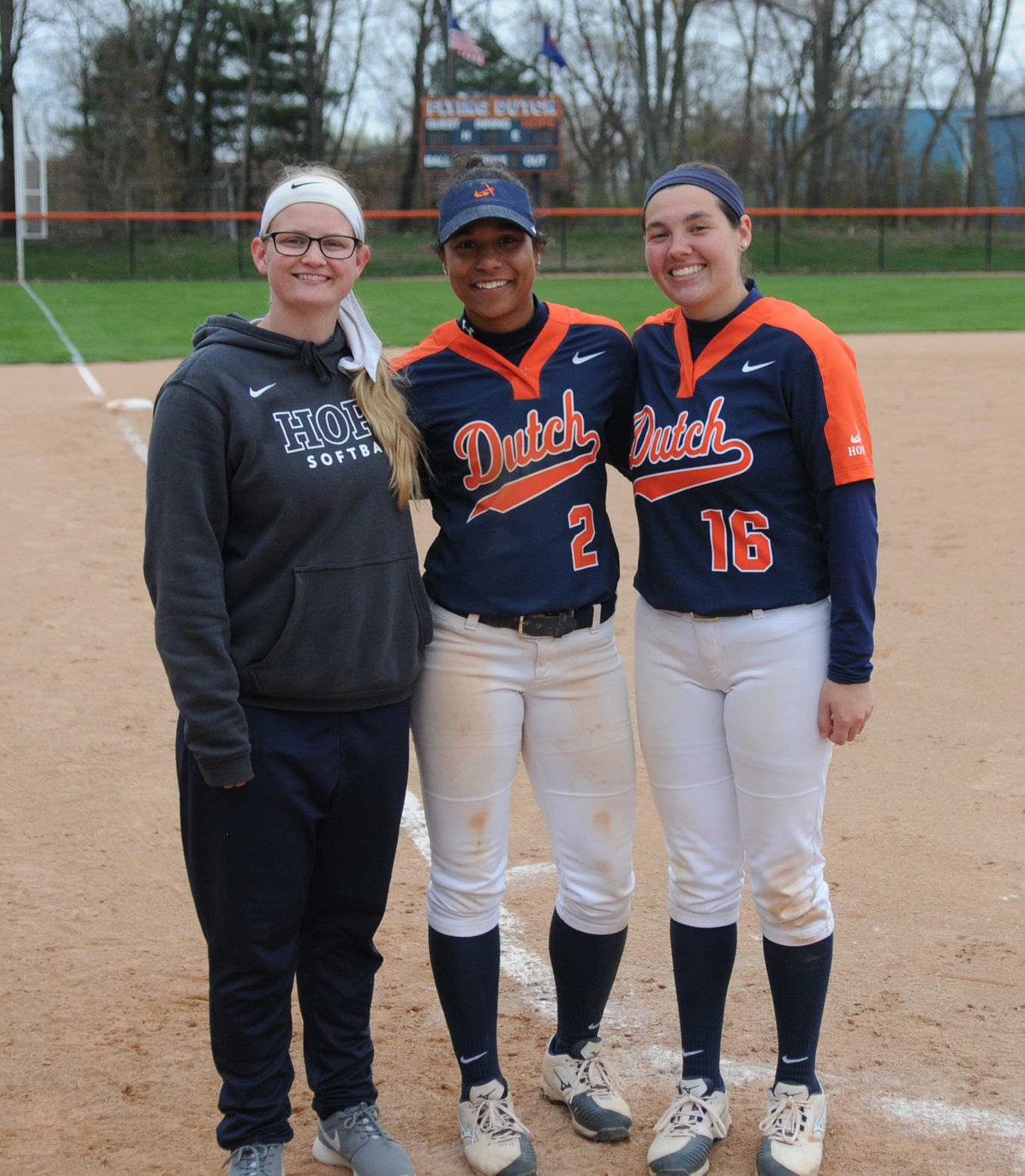 Hope softball seniors Ashley Ables, Noelle Jackson and Shay Pinhey pose for a picture together on home plate at Wolters Stadium.