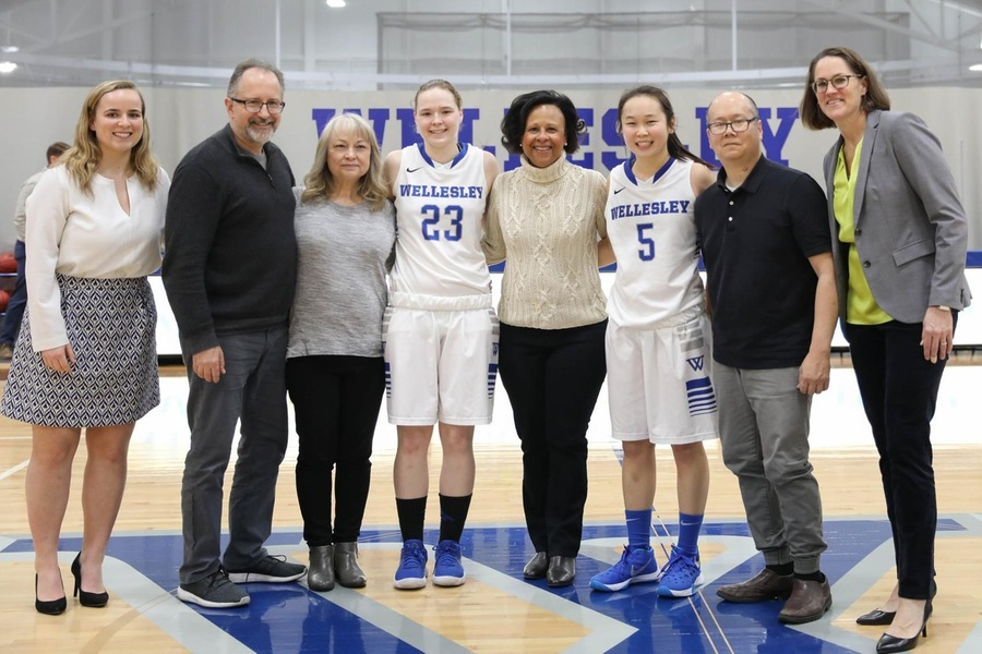 Wellesley seniors Chelsea Brown (left) and Kayla Jang (right) celebrated Senior Day with their families and Wellesley President Paula Johnson on Saturday (Miranda Yang).
