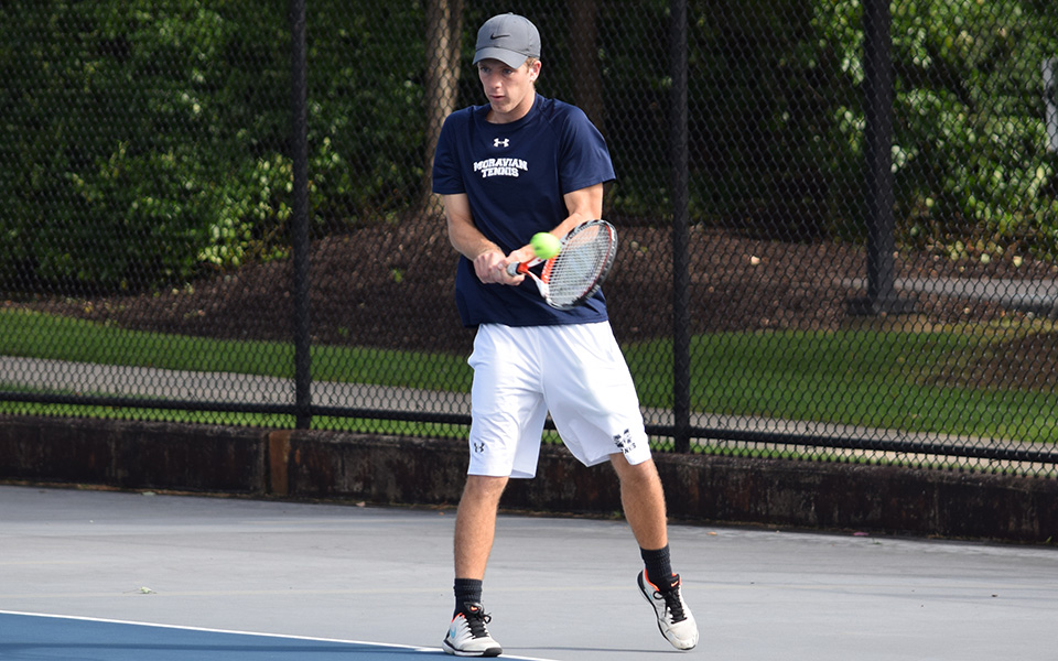Sophomore Mason Hudnall returns a shot during doubles action versus FDU-Florham in the fall 2018 season on Hoffman Courts.