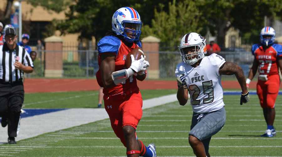 Cephus Smith hauls in a catch and turns it into a 48-yard touchdown in a 61-21 Blue Dragon rout of Fort Scott on Saturday at Gowans Stadium. (Bre Rogers/Blue Dragon Sports Information)
