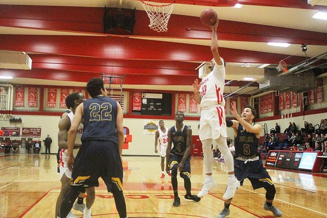 Mesa's Ramon Franklin (#10) powers up two of his 17 points on the night. (Photo by Aaron Webster)
