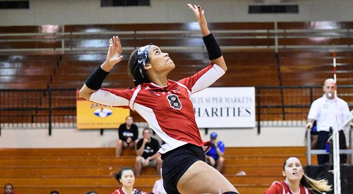 Suheily Colon goes for a kill against St. Petersburg. (Photo by Tom Hagerty, Polk State.)