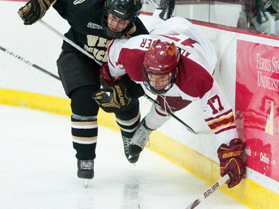 Ferris' Eric Alexander gets tripped up by a Western Michigan skater in Saturday's overtime tie.  (Photo by Ed Hyde)