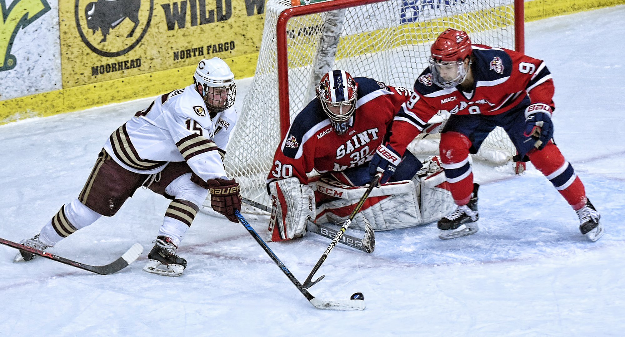 Mario Bianchi works the puck around the St. Mary's goal to set up the Cobbers' second goal in their MIAC quarterfinal game against the Cardinals.