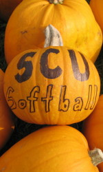 Softball Team Carves Pumpkins With Pomeroy Elementary and BAWSI
