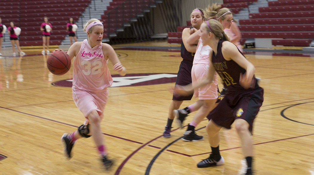Women's Hoops loses to Calvin College, 82-70, on Pink Day 2014