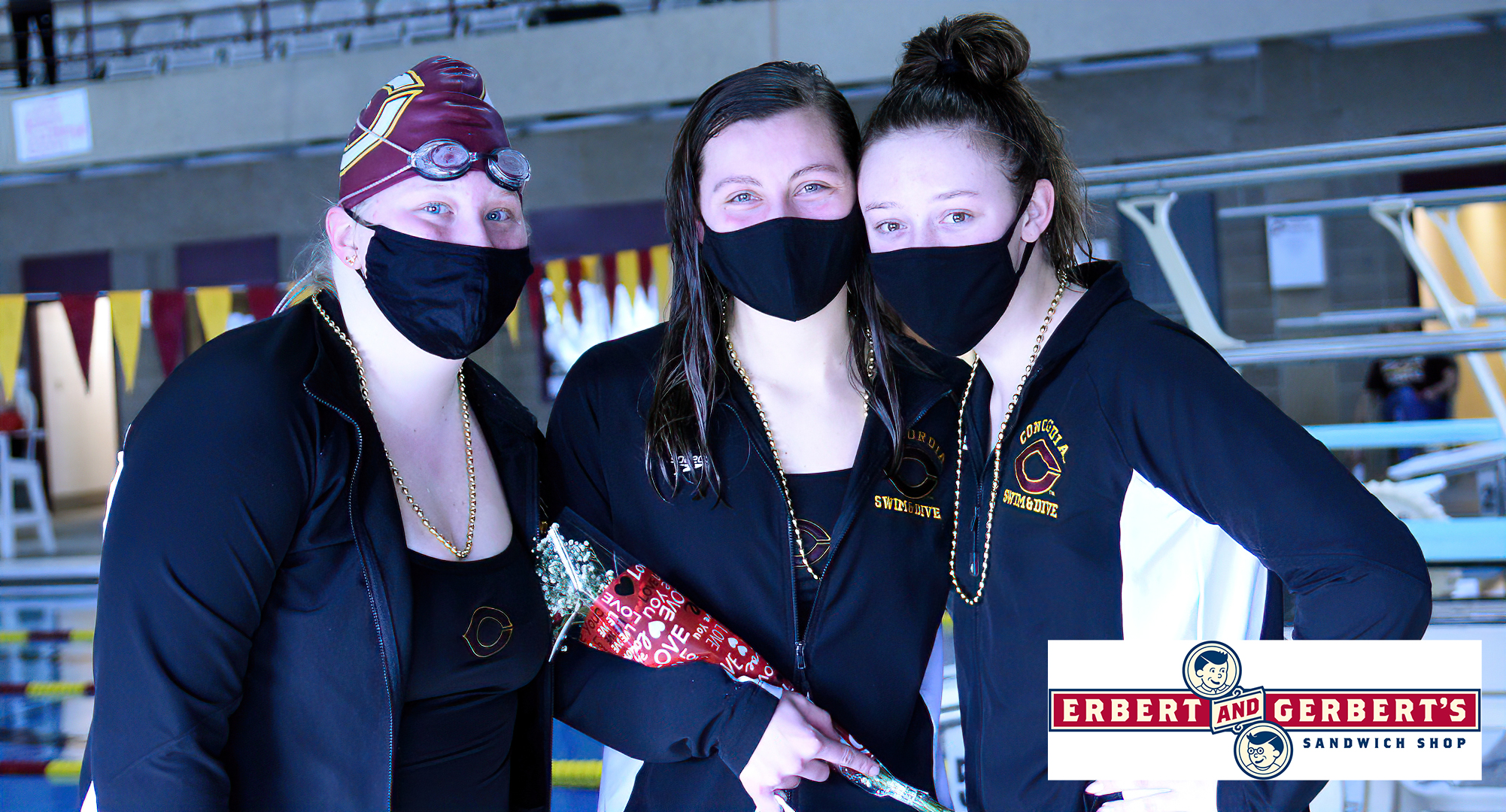 Senior Anna Backes (M) was honored by teammates, and received gifts from Lindsey Biebl (L) and Alex Rasmussen, during the Cobbers' dual meet with Augsburg. Backes won the 200 IM and 500 Free to help CC win 83-71.