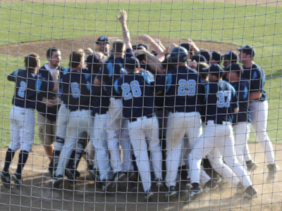 Team celebrates Kevin Murphy's walk off home run.