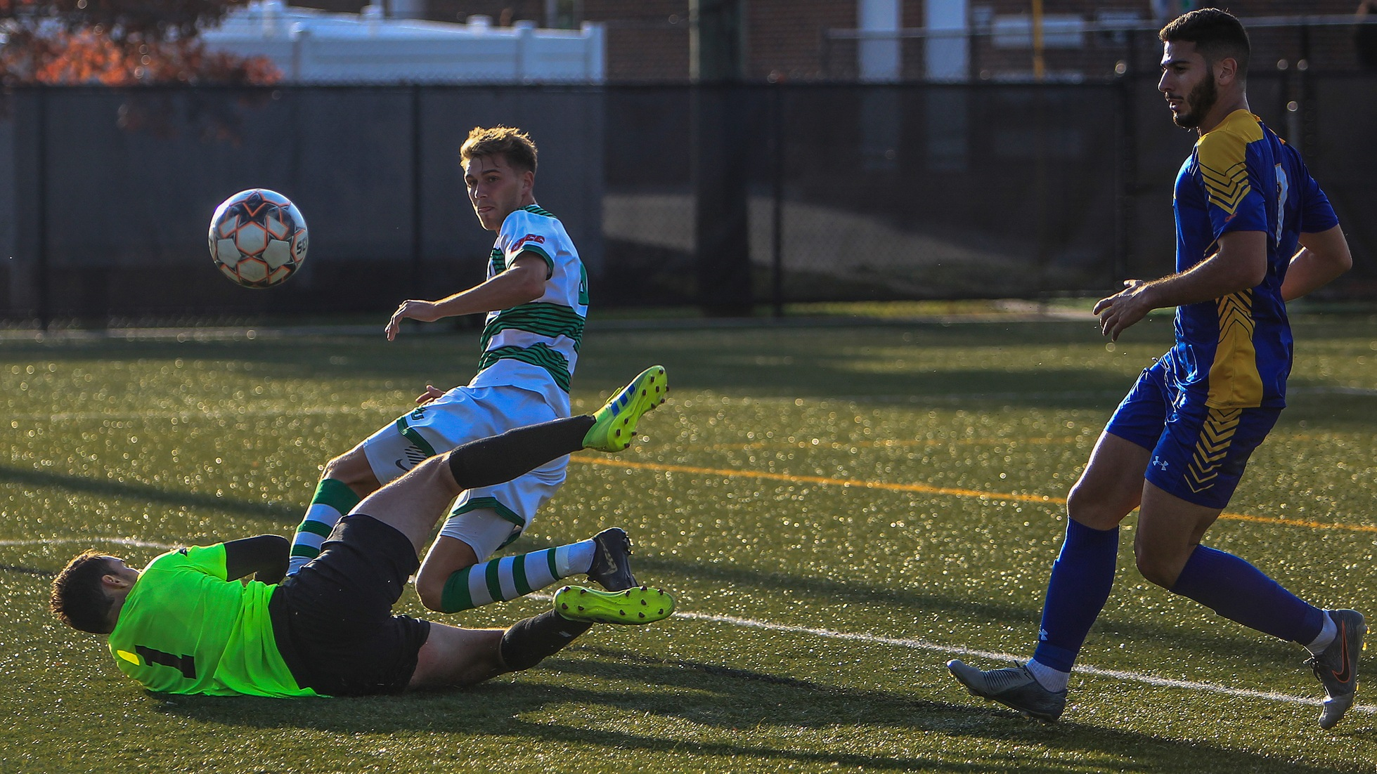 Wilmington University player Lorne Bickley (top) scores a goal against Concordia College goalkeeper Michael Varin  as Concordia?s Luca Wanna (R) follows the play during the first round of the CACC tournament at the Wilmington University Athletic complex in Newark, Delaware, November 11, 2019. Tim Shaffer Photo.