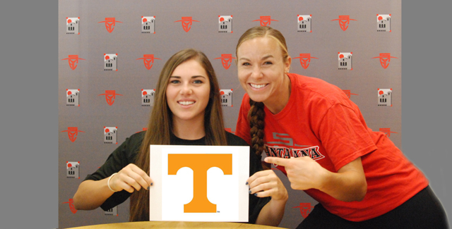 Alexandra Perkins (left) shows off the University of Tennessee 'T' after signing her National Letter of Intent. She is joined by Dons Head Coach Jessica Rapoza.