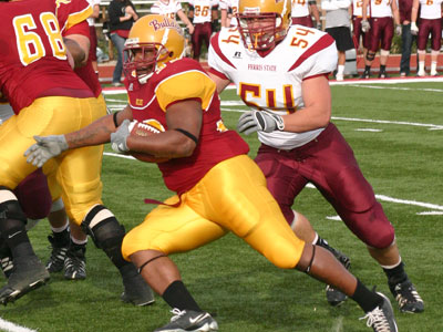 Senior Leon Curry carries the ball in Friday's spring game (Photo by Sandy Gholston)