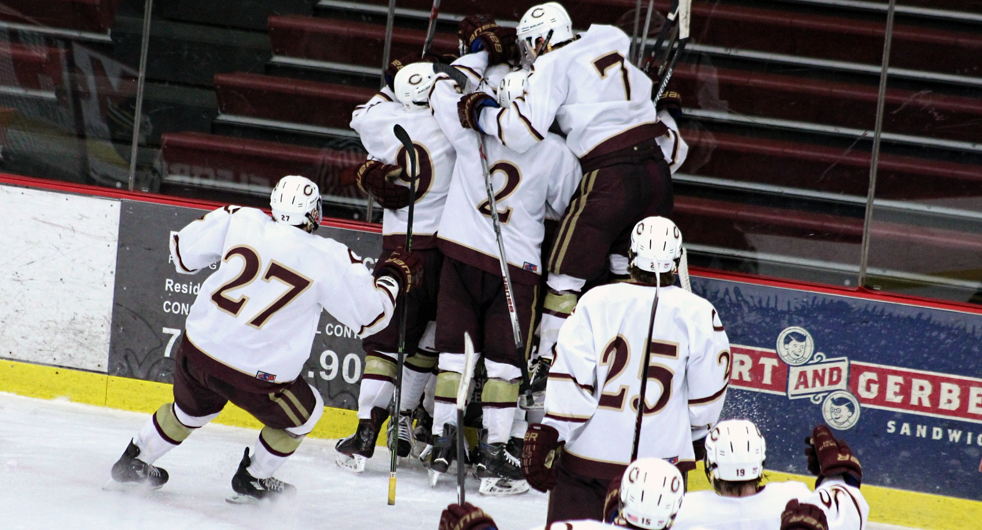 Concordia celebrates Garrett Hendrickson's game-winning goal in overtime during the team's 3-2 win over Gustavus.