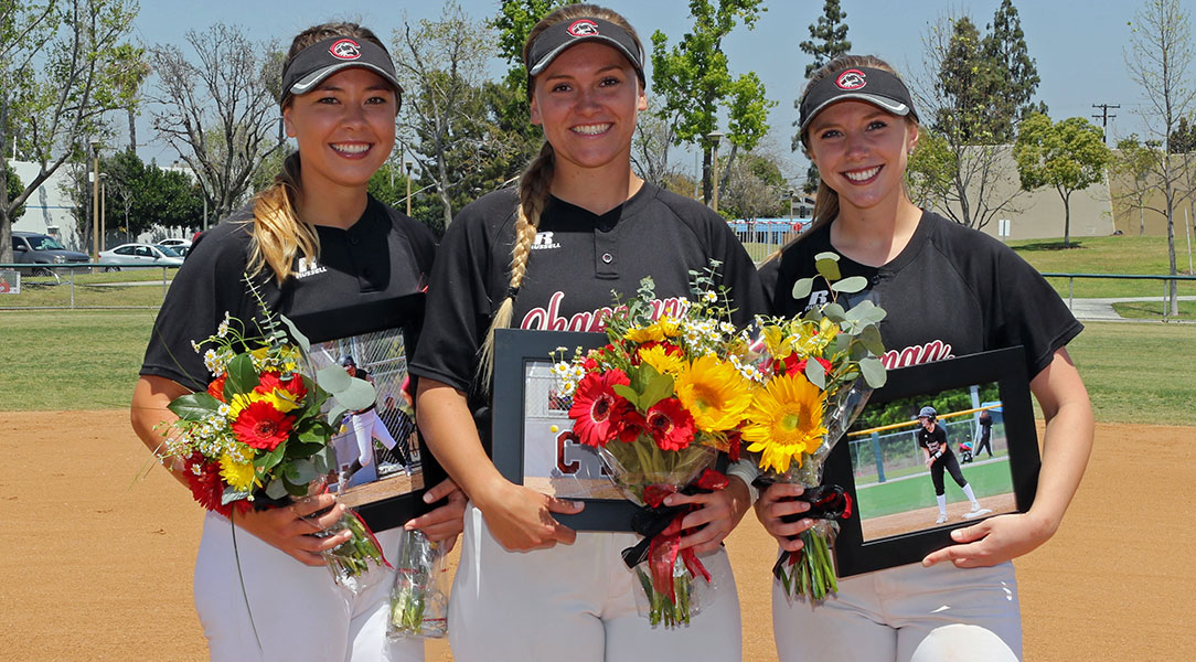 The three Chapman seniors pose for a picture.