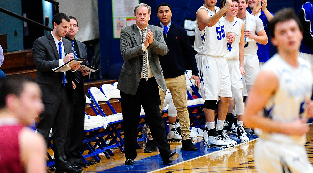 Glenn Robinson stands and claps for his time on the sidelines as the Diplomats get back on defense in a game against Muhlenberg. (F&M athletics photo)
