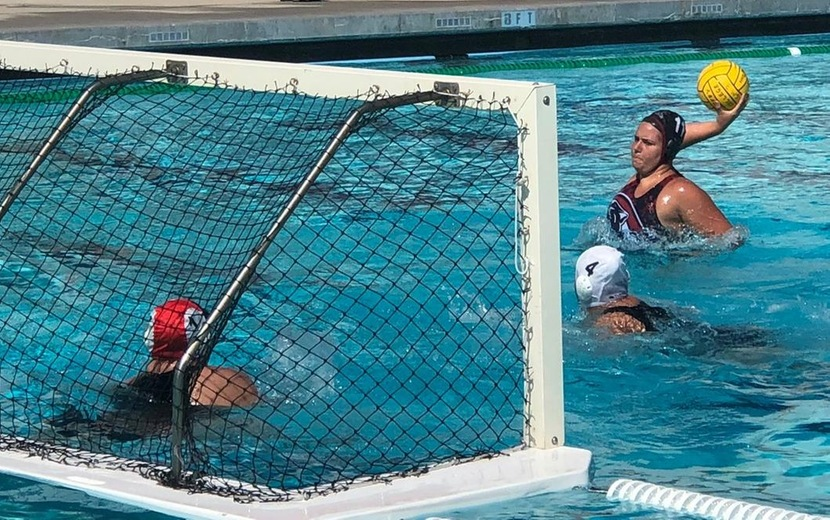women's water polo player goes for a goal